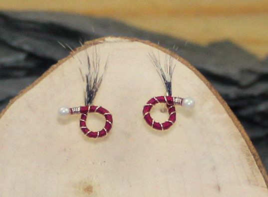 Wine red body black and white feather round nymph earrings