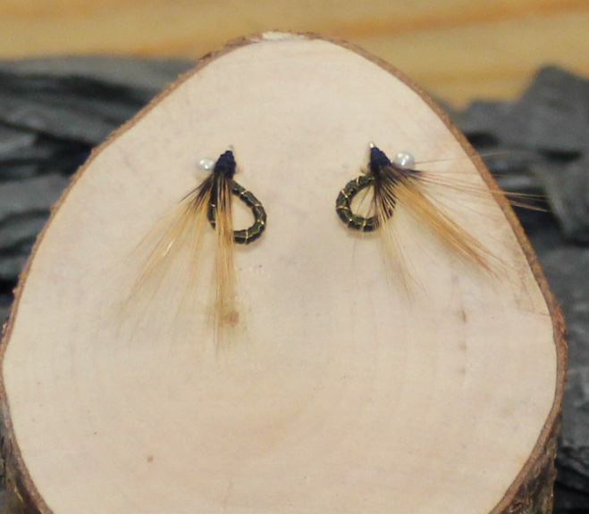 Dark green round nymph earrings with hackle