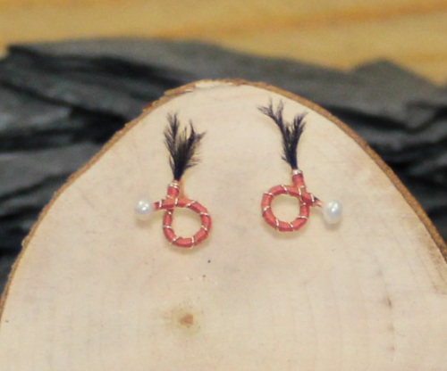 Pink body black feather round nymph earrings