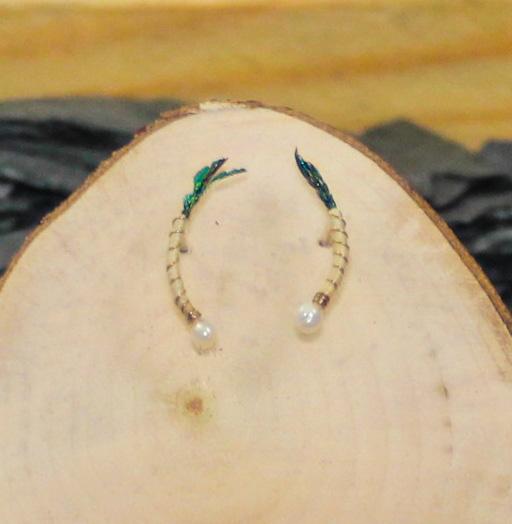 Beige body peacock feather nymph earrings