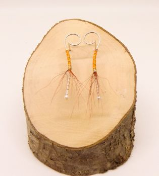 Orange ballerina earring