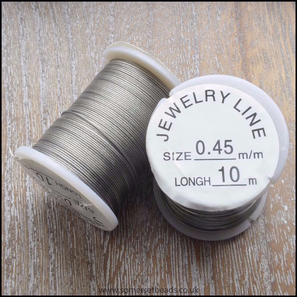 Silver 0.45mm 7 Strand Tiger Tail Beading Wire. Pack of 4 Reels