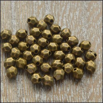4mm Antique Bronze Faceted Oval Spacer Beads.