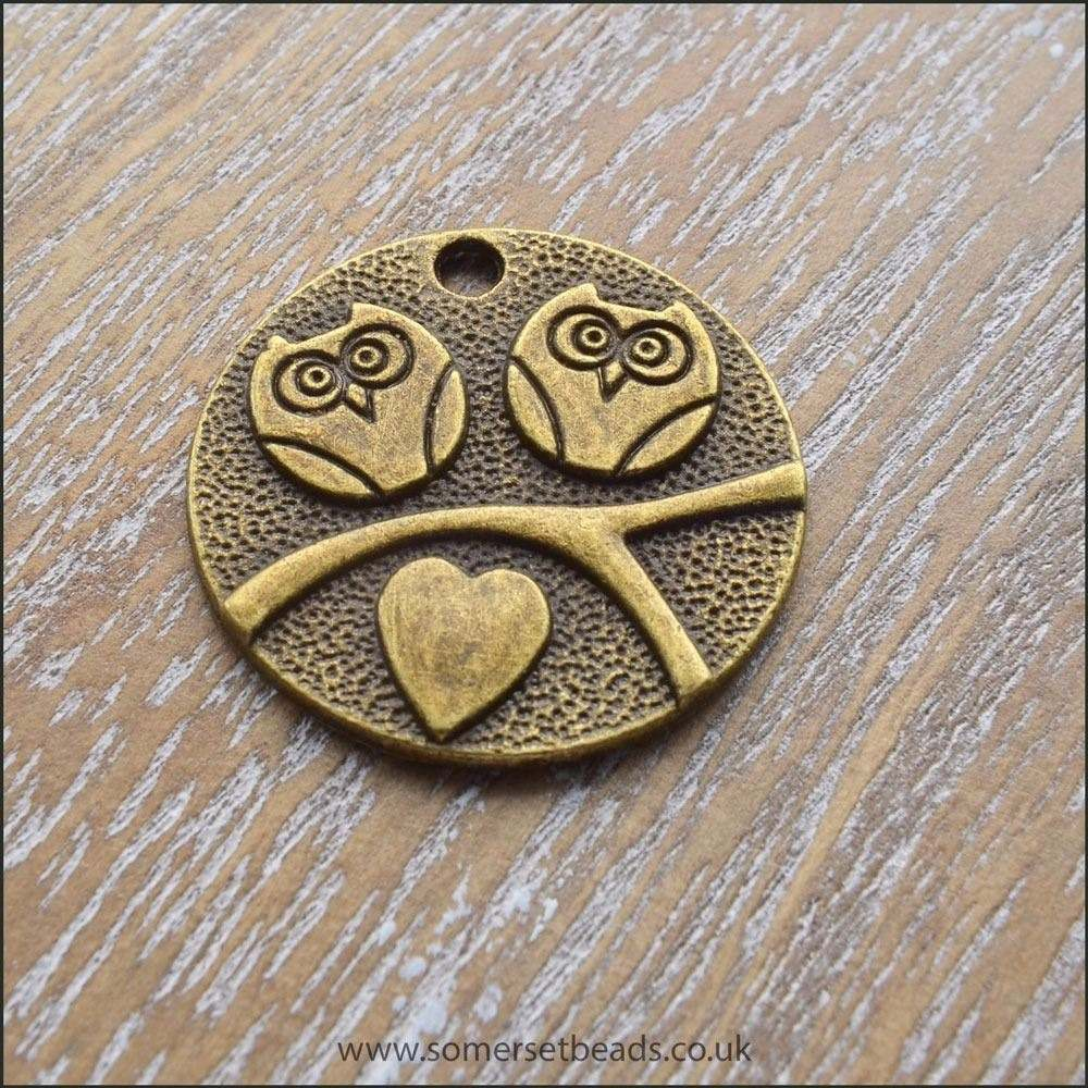 Antique Bronze Flat Round Owl Charm