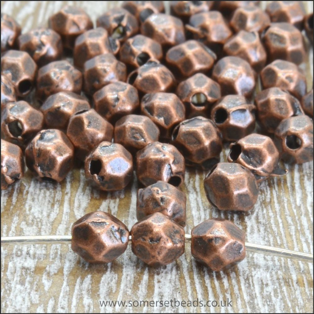 4mm Copper Faceted Oval Spacer Beads.