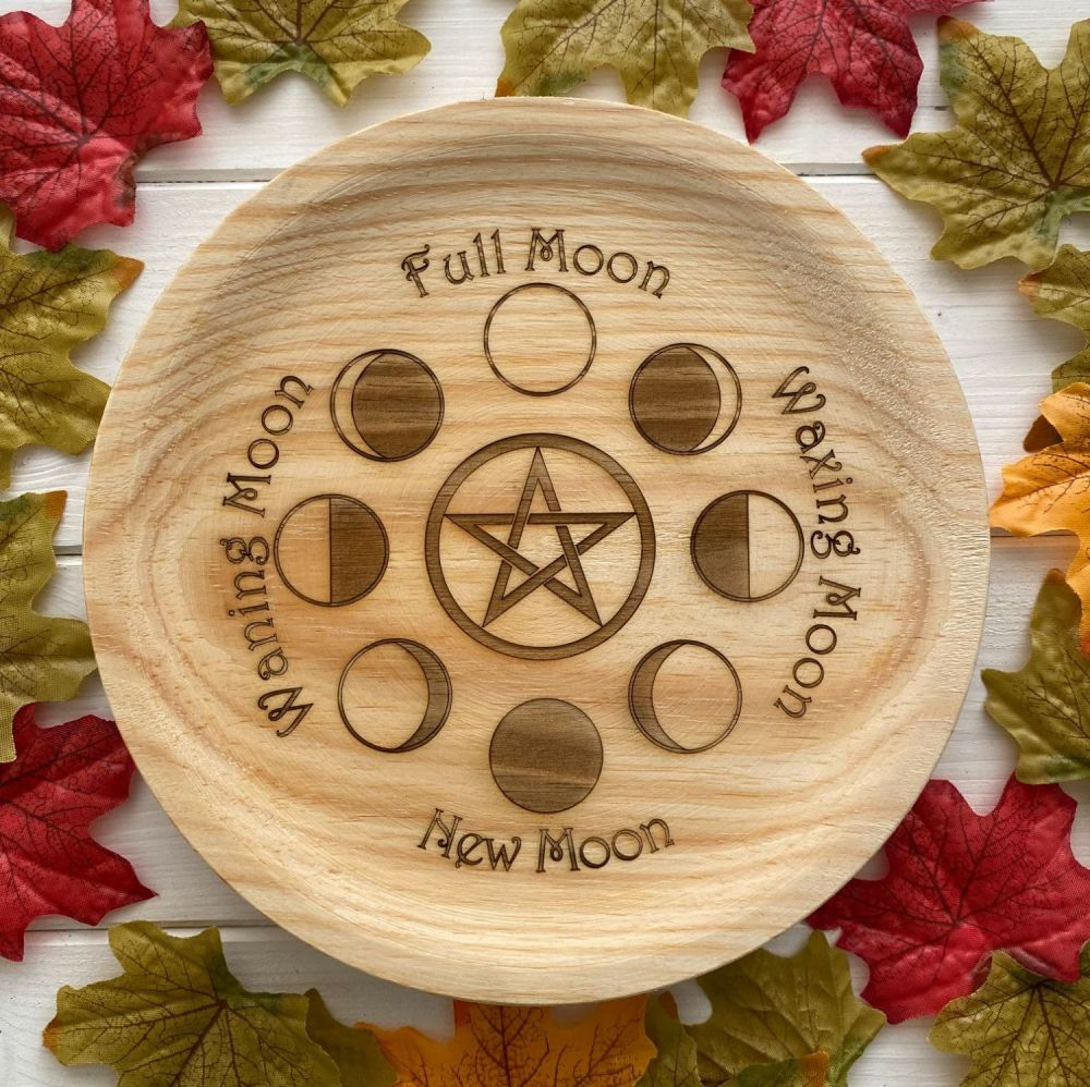 A Rustic Hand Crafted Wooden Spell Casting Plate with Moon Phase