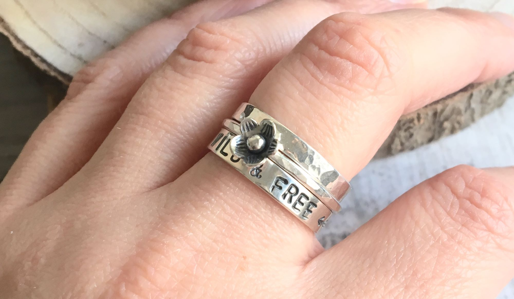 Sterling silver stacking rings with stamped quotes and tiny flowers