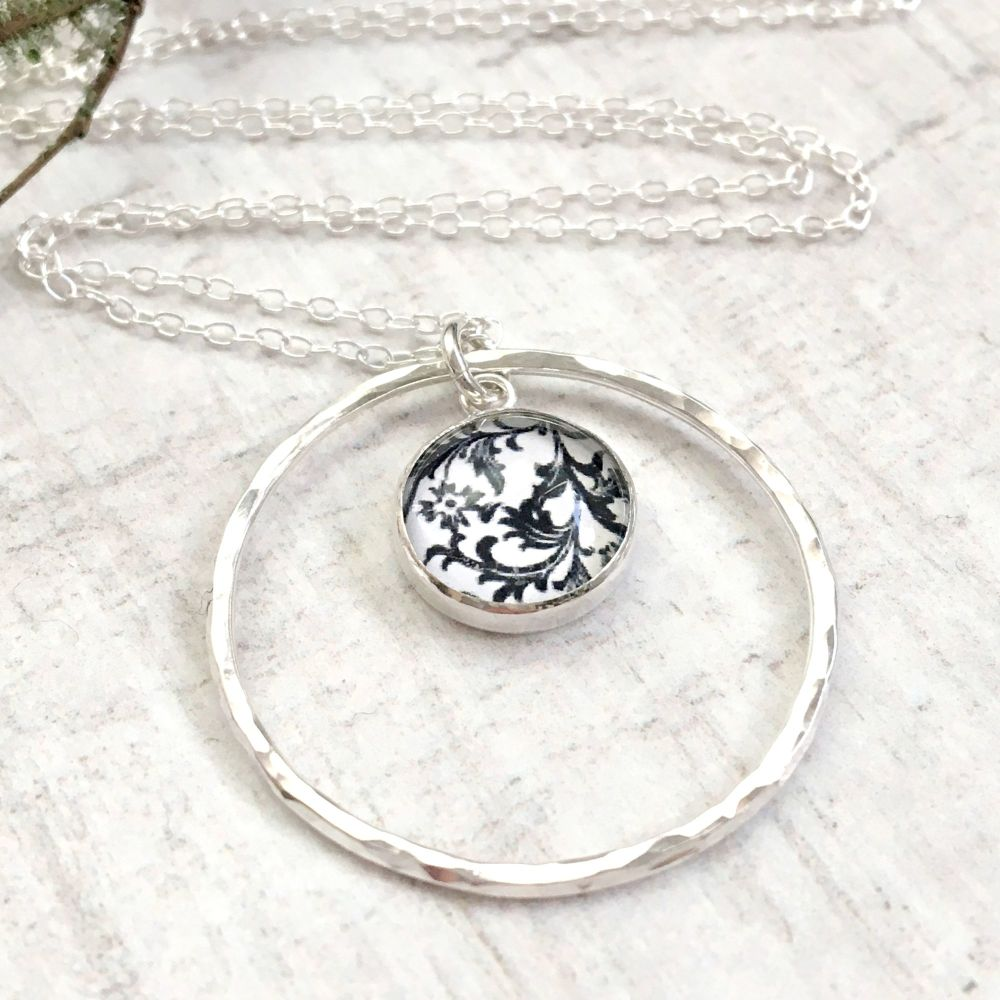 Sterling Silver Floral Black & White Art Charm with Hammered Circle Frame