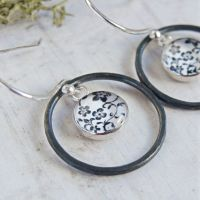 Oxidised Sterling Silver Floral Illustration Charm Circle Framed Dangly Earrings