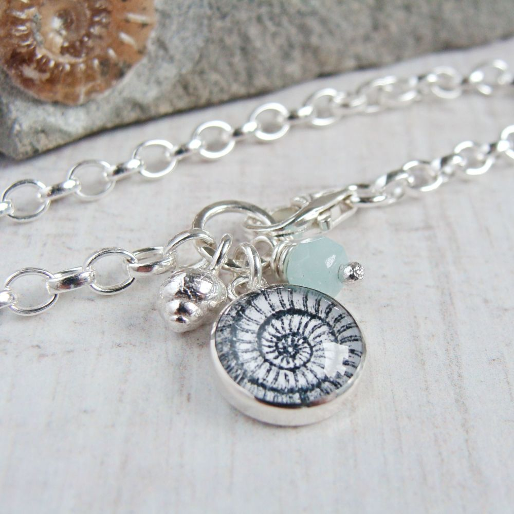 Sterling Silver Ammonite Illustration Charm Bracelet with Tiny Silver Shell