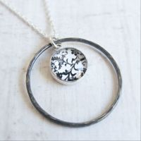 Oxidised Sterling Silver Floral Black & White Art Charm with Hammered Circle Frame