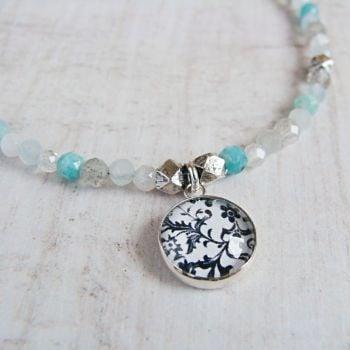 Faceted Multi Gemstone Beaded Bracelet with Sterling Silver Floral Illustration Charm