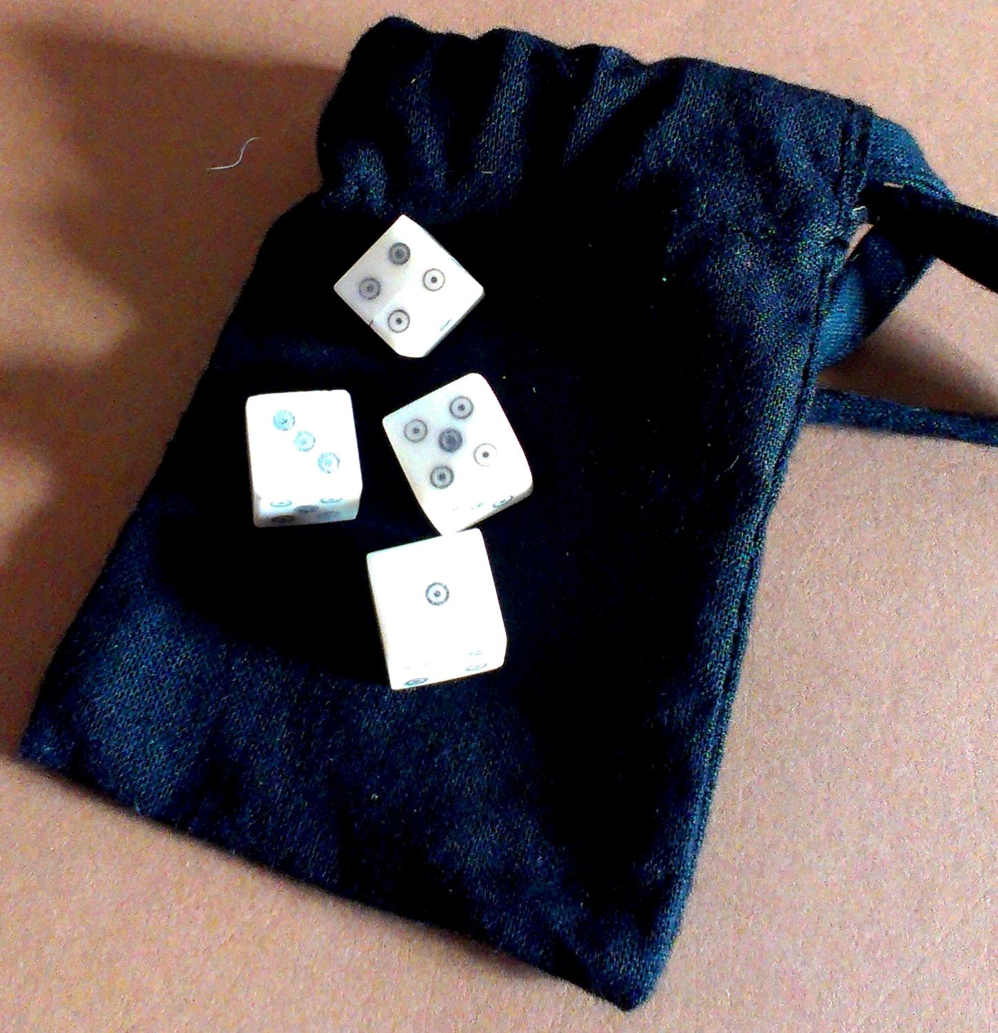 Later historic games set - four ring-and-dot bone dice