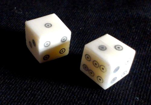 Two ring-and-dot style bone dice from The Historic Games Shop