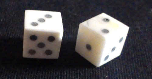 Two solid-pip style bone dice from The Historic Games Shop