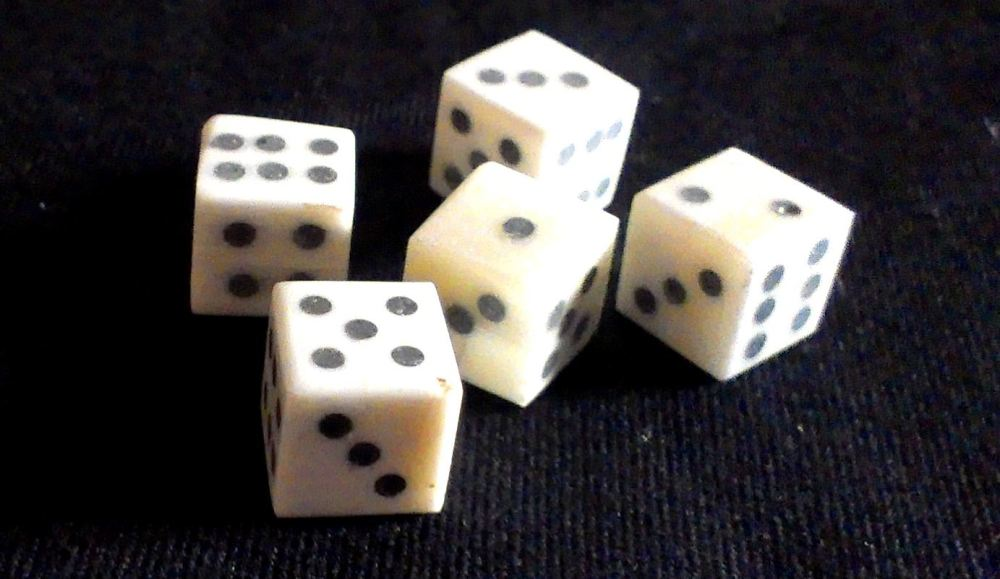 Five solid-pip style bone dice from The Historic Games Shop