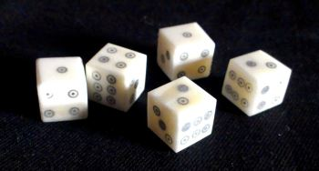 Five ring-and-dot bone dice