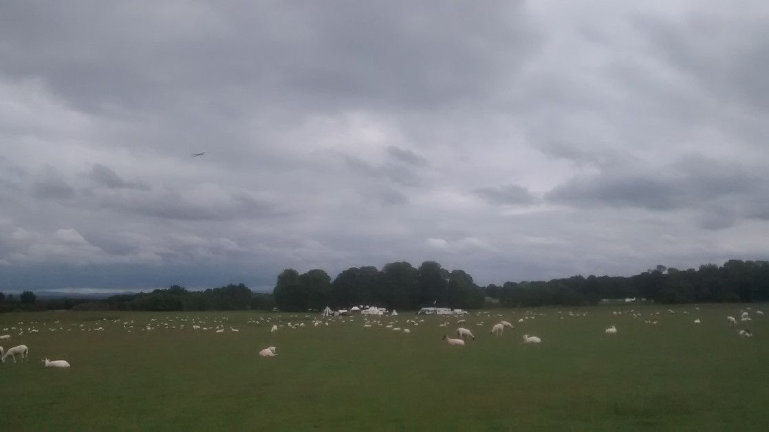 Aeroplane over Tatton Park - part of the Medieval Fair beginning to set up, with the Old Hall hidden behind the trees...