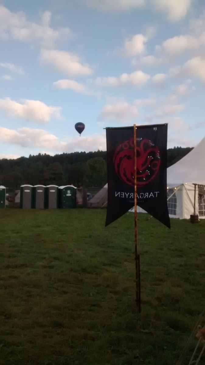 Is it a dragon? No, it's a fire-breathing hot air balloon floating above the House Targaryen banner at Game of Thrones Fest 2019