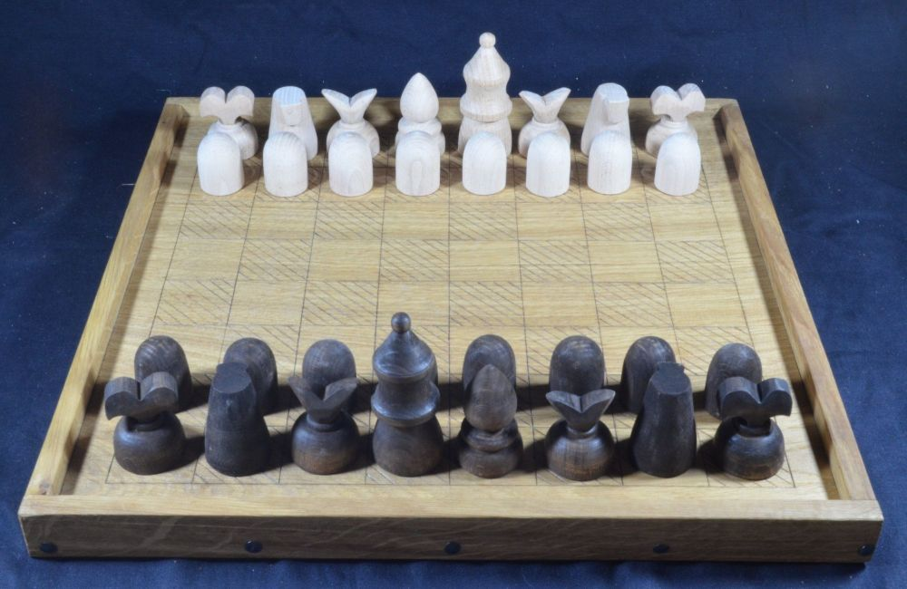 Reconstruction of Caxton's chess set, shown on our medieval chess board