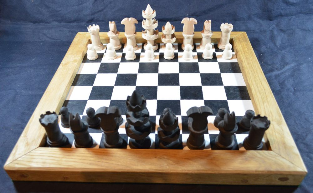 Reconstruction of the Selenus chess set, shown on our painted chess board