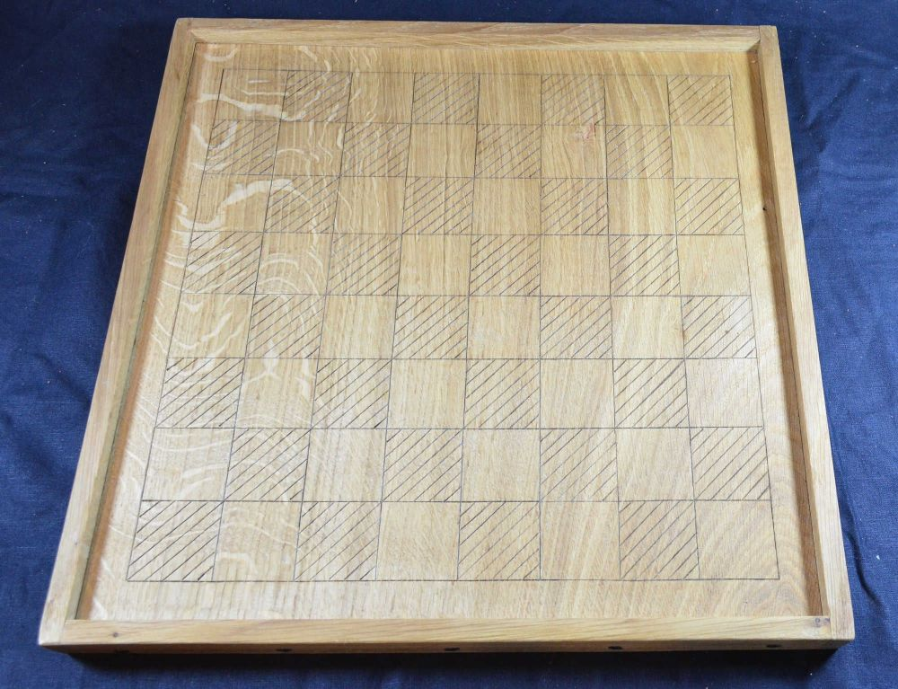 Unpainted quarter-sawn oak chess board of early medieval style