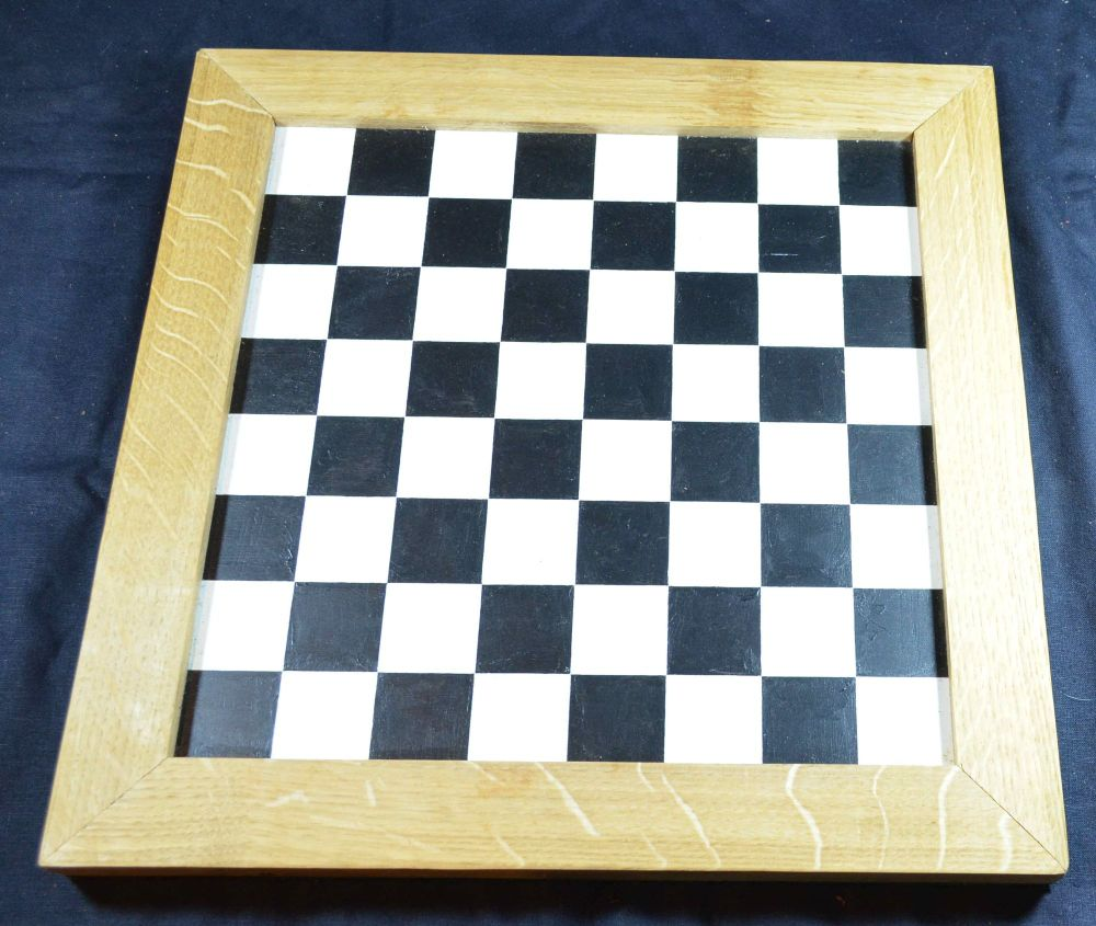 Hand-painted chess board, black and white squares, with oak border