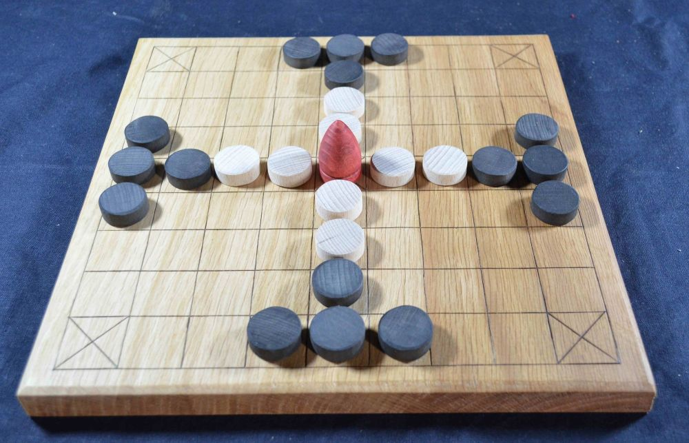 9 x 9 tafl board of oak, with beechwood playing pieces