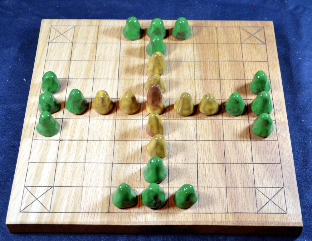9 x 9 tafl board of oak, with glazed ceramic playing pieces