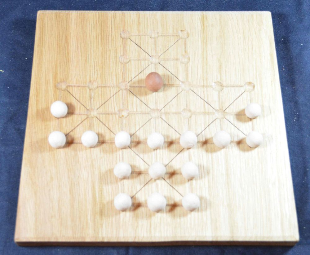 Fox and Geese gameboard of quarter-sawn oak, with ceramic playing pieces
