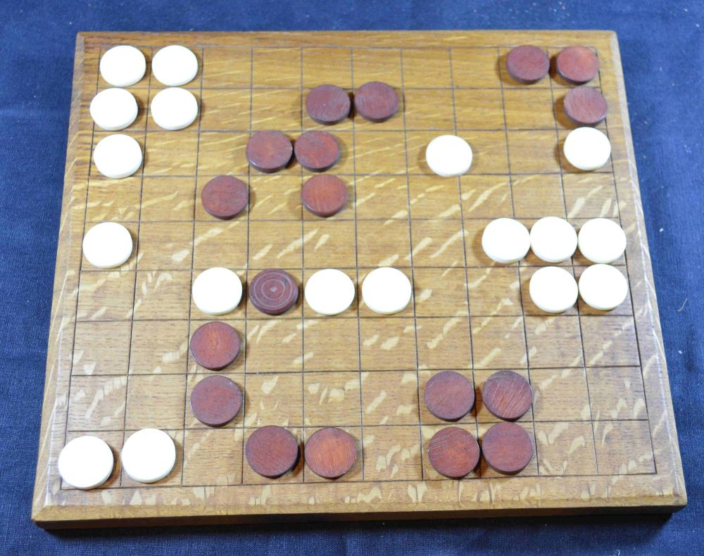 Oak Ludus Latrunculorum board, bone counters, with game in play