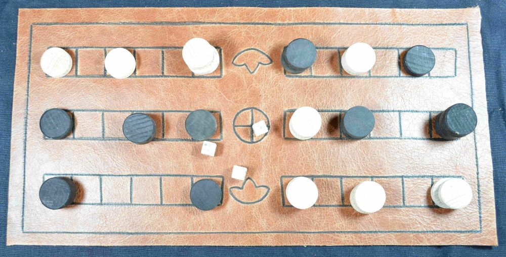 Duodecim Scripta  or Alea, 3-row leather board with dice; game in play