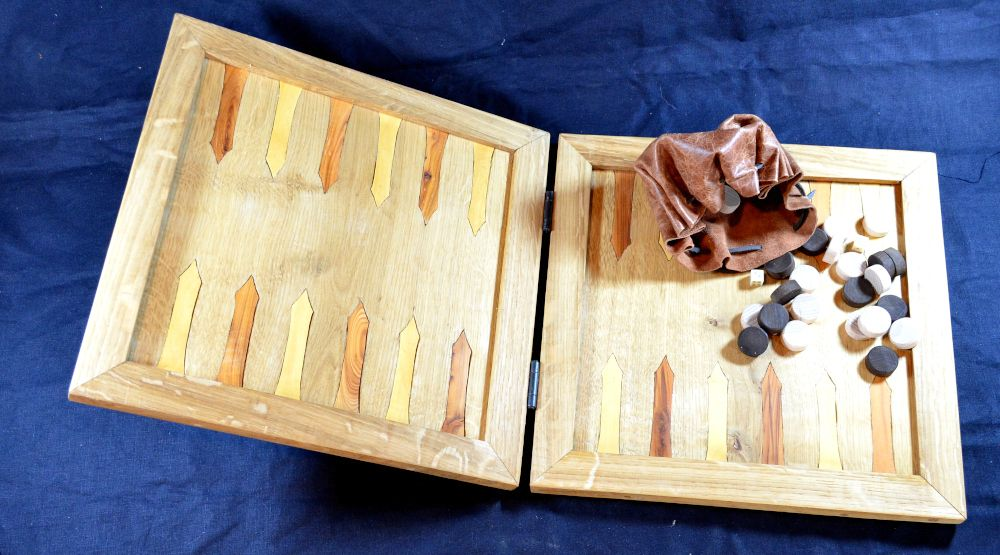 Reproduction oak backgammon board, with inlayed box and yew points; with beech wood counters and bone dice in leather pouch