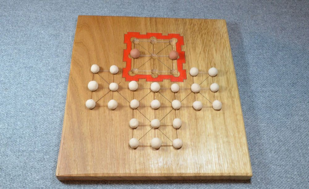 Asalto game, with oak board and fired clay playing pieces
