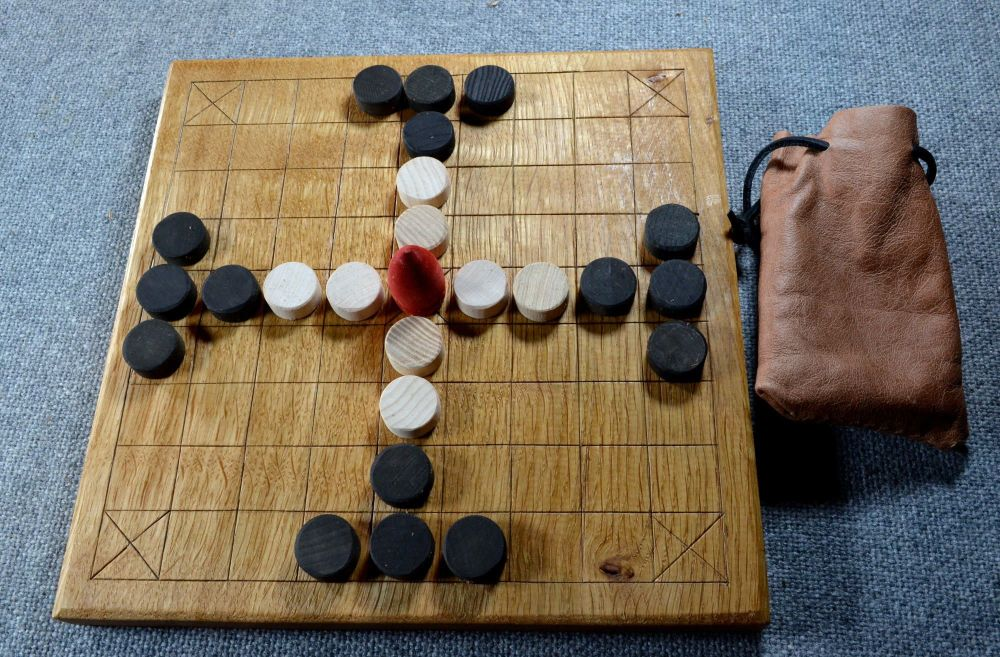 "Tablut, oak board 10"" x 10"" with beechwood playing pieces in a leather pouc"