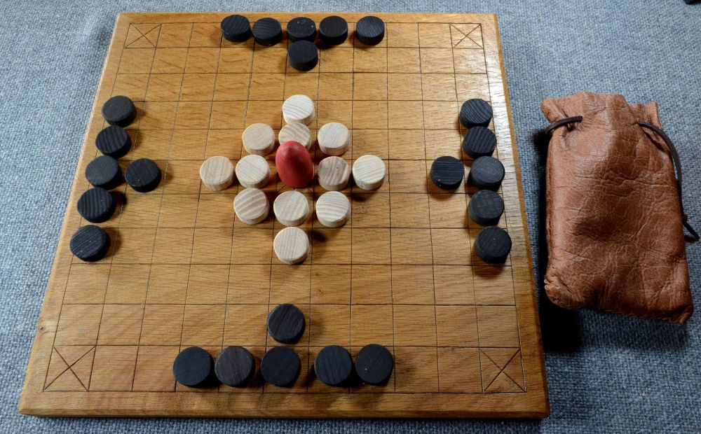 11 x 11 variant of tafl; quarter-sawn oak board with hardwood playing piece