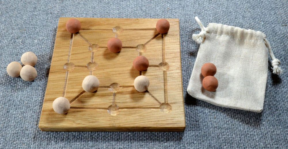 Six Men's Morris, oak board with ceramic playing pieces and linen pouch