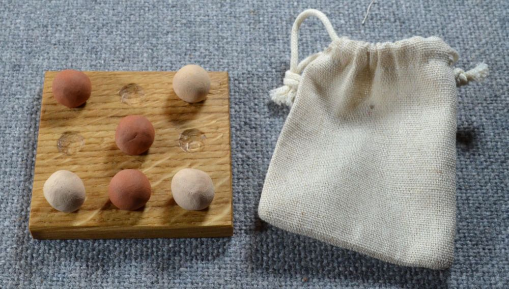 Nine Holes, oak board with ceramic playing pieces and linen pouch