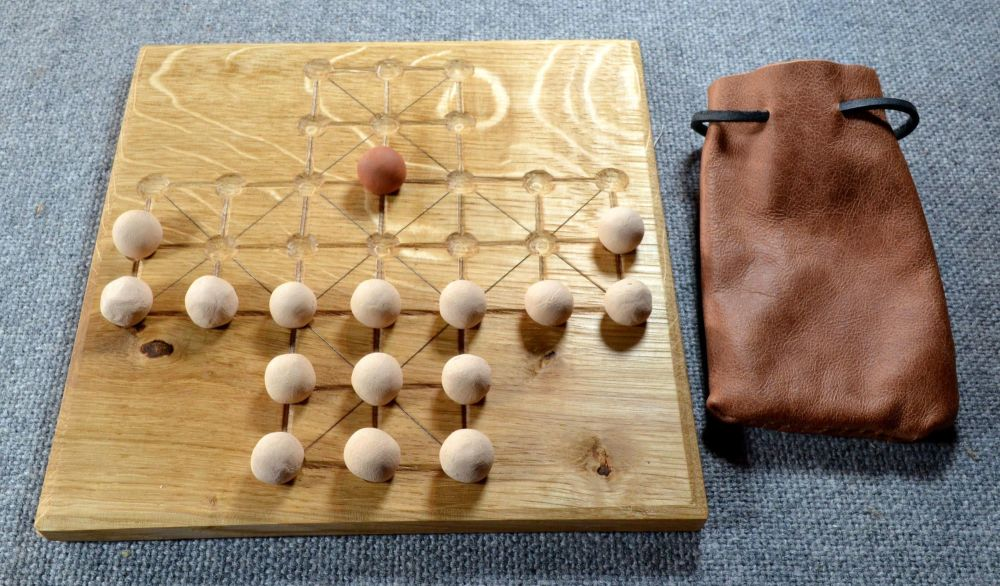 Fox and Geese gameboard in 17th century layout, with ceramic playing pieces