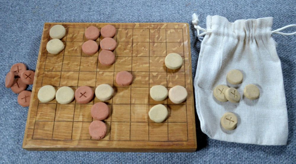 Ludus Latrunculorum board of 8 x 7 squares, with ceramic playing pieces