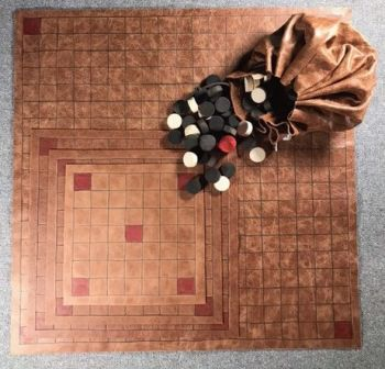 Tafl Offer 1 -  four leather boards, with playing pieces in a leather pouch