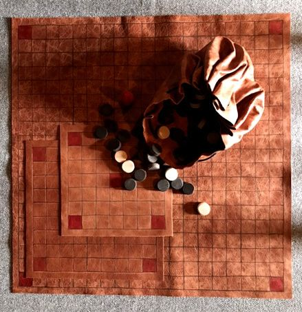 Tafl Offer 2 -  three leather boards, with playing pieces in a leather pouc