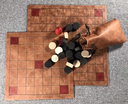 Tafl Offer 3 -  two leather boards, three games; with playing pieces in a l