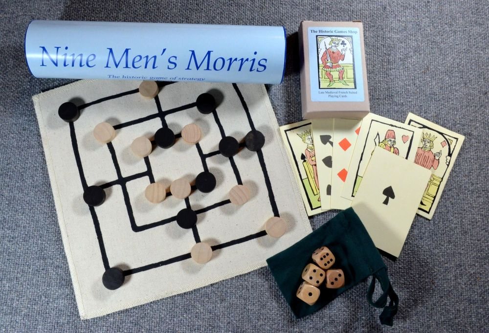Fifteenth century reproduction playing cards; Nine Men's Morris board game;