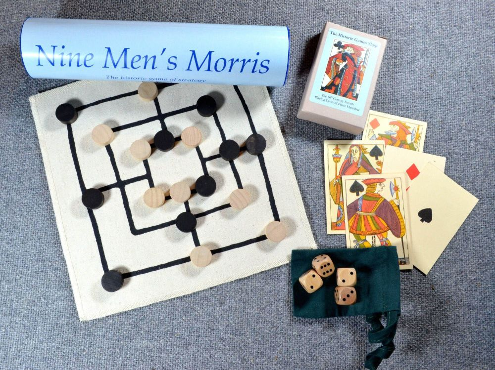 Sixteenth century reproduction playing cards; Nine Men's Morris board game;
