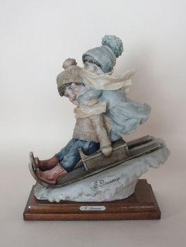 Giuseppe Armani Figurine, Boy and Girl on Sledge, Signed 1982 Florence