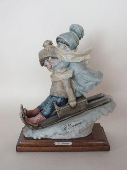 Giuseppe Armani Figurine, Boy and Girl on Sledge, Signed 1982 Florence