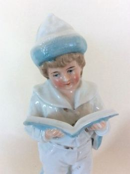 Antique Porcelain Boy Figurine. Heubach, Germany.