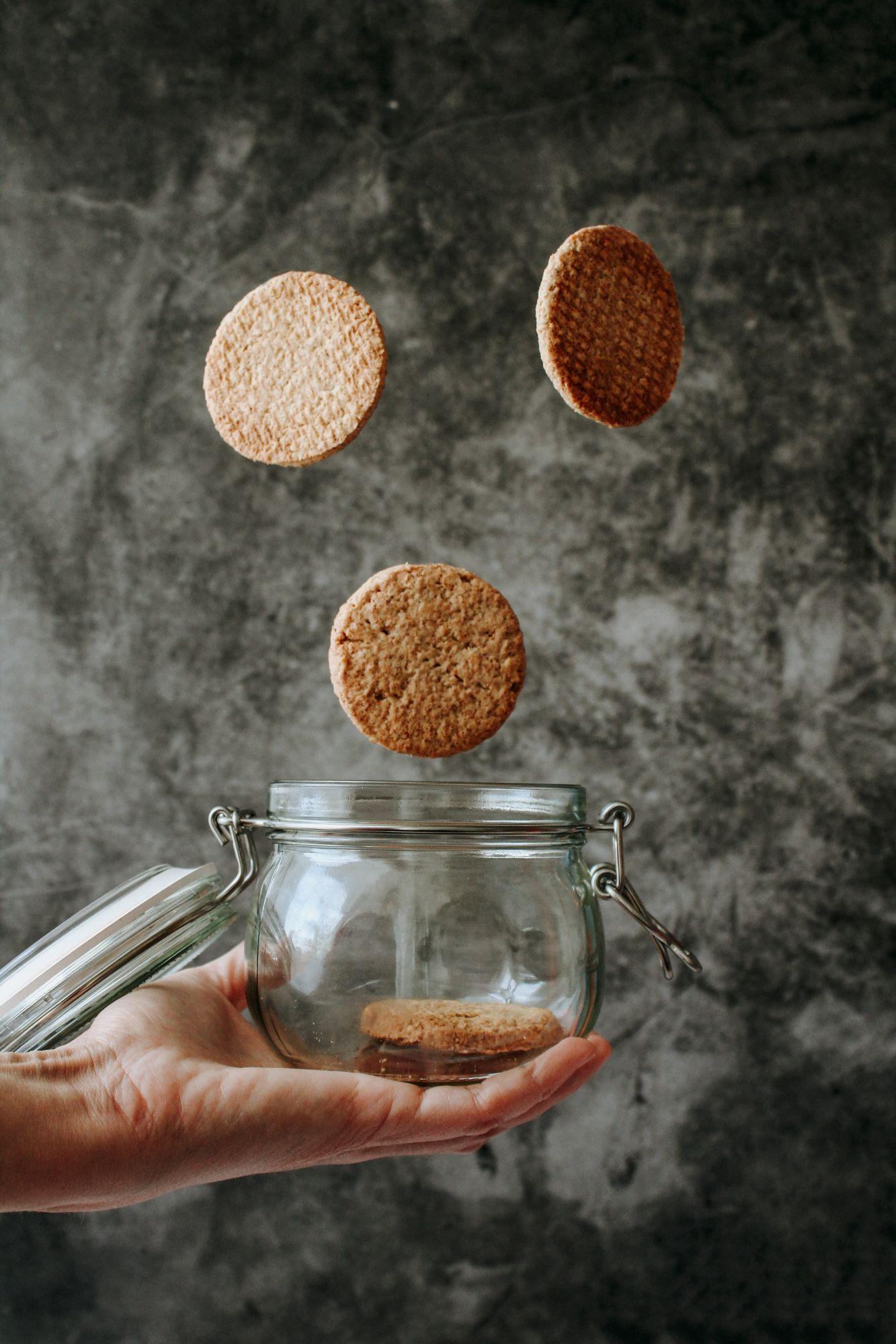 Cookies dropping into a Mason Jar