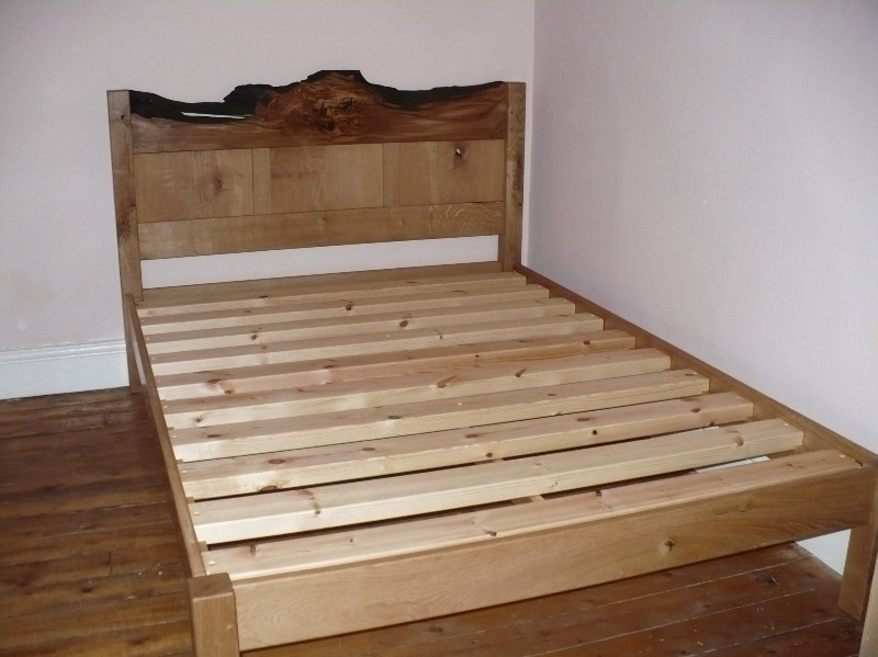 double bed with an interesting oak headboard